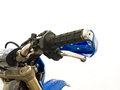Throttle control close up of a motorcycle and handlebar in snow outdoor shot with particular focus Stock Photos