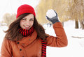 Throwing snowball woman in a red cap Stock Photography