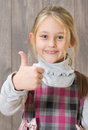 Thumb as a sign that the excellent little girl showing Royalty Free Stock Photography