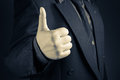 Thumb up closeup businessman show Stock Images