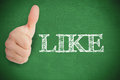 Thumb up representing social network logo on green background besides like Stock Photo