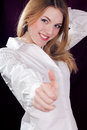 Thumb up & sexy beautiful young woman smiling Royalty Free Stock Photos