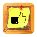 Thumb up yellow sticker on message board cork Stock Images