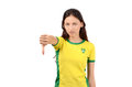 Thumbs down for brazil unhappy fan with brazilian flag on her yellow t shirt isolated on white Stock Images
