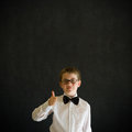 Thumbs up boy dressed up as business man sign teacher or student on blackboard background Stock Images