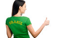 Thumbs up for brazil attractive girl with brasil written on her green t shirt isolated on white Royalty Free Stock Photos