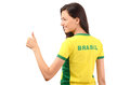 Thumbs up for brazil attractive girl with brasil written on her yellow t shirt isolated on white Royalty Free Stock Image