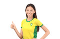 Thumbs up for brazil attractive girl with brazilian flag on her yellow t shirt isolated on white Stock Images