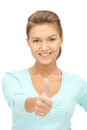 Thumbs up bright picture of lovely teenage girl with Stock Image