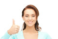 Thumbs up bright picture of lovely teenage girl with Royalty Free Stock Photo