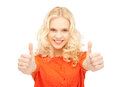 Thumbs up bright picture of lovely teenage girl with Royalty Free Stock Image