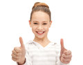 Thumbs up bright picture of lovely teenage girl with Royalty Free Stock Images