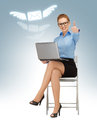 Thumbs up business woman with laptop showing Royalty Free Stock Photos