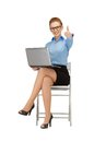 Thumbs up business woman with laptop showing Royalty Free Stock Images