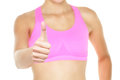 Thumbs up fitness woman in sports bra close up closeup of female hand sign gesture isolated on white background Royalty Free Stock Photography