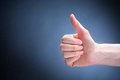 Thumbs up gesture a hand making a of success or approval with copy space next to it Royalty Free Stock Image