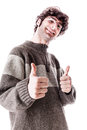 Thumbs up an handsome guy maybe a student in casual clothing with isolated over white Stock Image