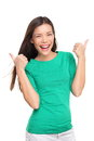Thumbs up happy excited woman isolated on white background in green t shirt cheerful joyful and elated girl looking at camera Royalty Free Stock Photos