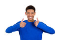 Thumbs up man closeup portrait of happy young smiling giving two at you camera gesture isolated on white background positive human Stock Images