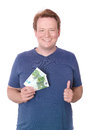 Thumbs up for money young happy man holding two euro banknotes and giving you a isolated on white Royalty Free Stock Photos