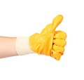 Thumbs up with a orange rubber glove isolated on white background Royalty Free Stock Photo