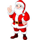Thumbs up santa claus christmas doing a and smiling Stock Photo