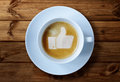 Thumbs up sign in coffee or like symbol froth Stock Images