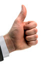 Thumbs up signal hand gesture achieved by a closed fist held with the thumb extended upward Royalty Free Stock Photo