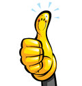 Thumbs up smiling yellow cartoon glove character in a hand Stock Photo