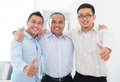 Thumbs up Southeast Asian businessmen Royalty Free Stock Photo