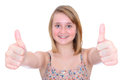 Thumbs up teen girl beautiful smiling and giving a double shallow dof with focus on hands Stock Images
