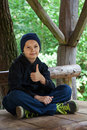 Thumbs up a teenage boy sitting giving Royalty Free Stock Photo