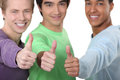 Thumbs up three lads Royalty Free Stock Photography
