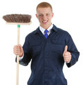 Thumbs up worker with broom Stock Image