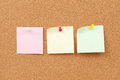 Thumbtack and note paper group close up view of on corkboard Royalty Free Stock Photo
