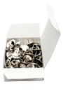Thumbtacks im Kasten Stockbilder