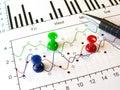 Thumbtacks and pen Stock Images