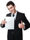 Thumbup a business man with a document gives a Stock Image