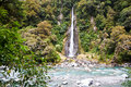 Thunder creek fall in tropical forest Royalty Free Stock Photo