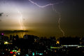 Thunder storm lighting bolt on the horizontal sky and city scape Royalty Free Stock Photo