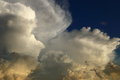 Thunderstorm anvils blown off from their parent cumulonimbus clouds Stock Photography