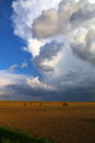 Thunderstorm large cloud rises above the landscape Stock Images