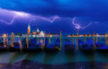 Thunderstorm with lightning in the sky on the grand canal italy Stock Photo