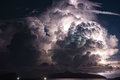 Thunderstorm over island at night Royalty Free Stock Photo