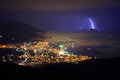 Thunderstorm over night city near sea Stock Photo