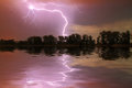 Thunderstorm on the river at night Royalty Free Stock Photo