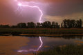 Thunderstorm on the river in summer Stock Photos