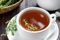 Thyme tea in a cup and fresh herbs Royalty Free Stock Photo