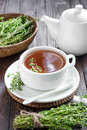 Thyme tea in a cup and fresh herbs Royalty Free Stock Photos