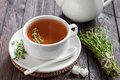 Thyme tea in a cup and fresh herbs Stock Photo